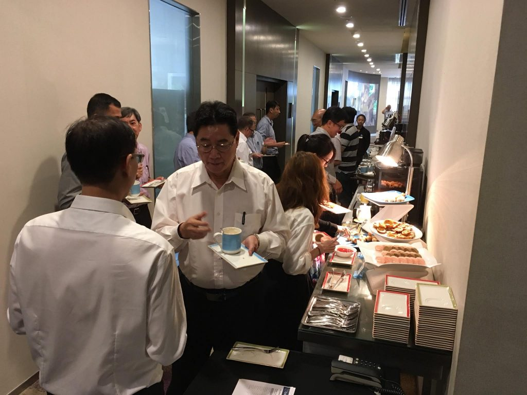 Create Smarter Buildings Seminar Attendees network over tea break